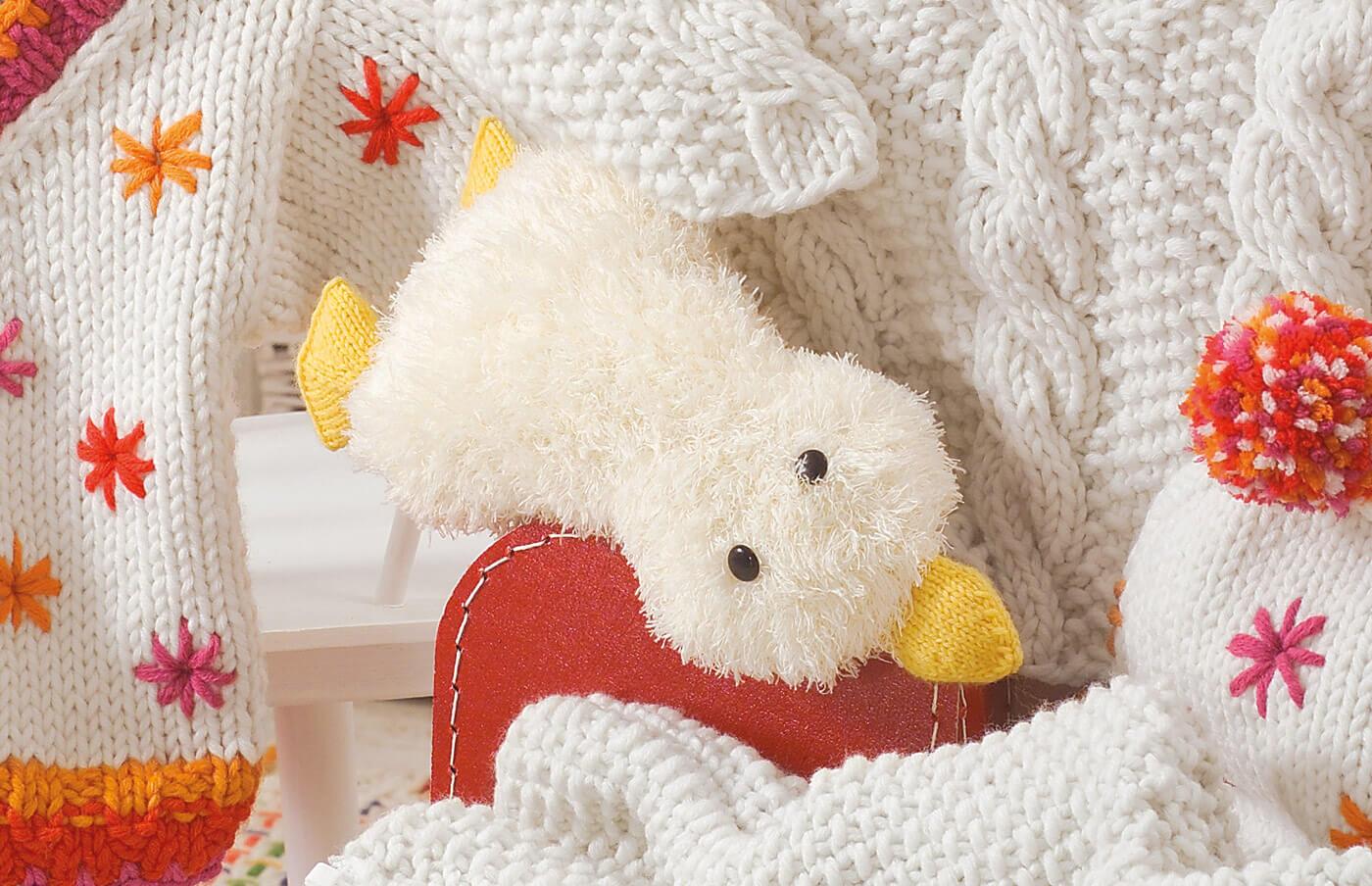 Kuschelige Strick-Ente für Kinder