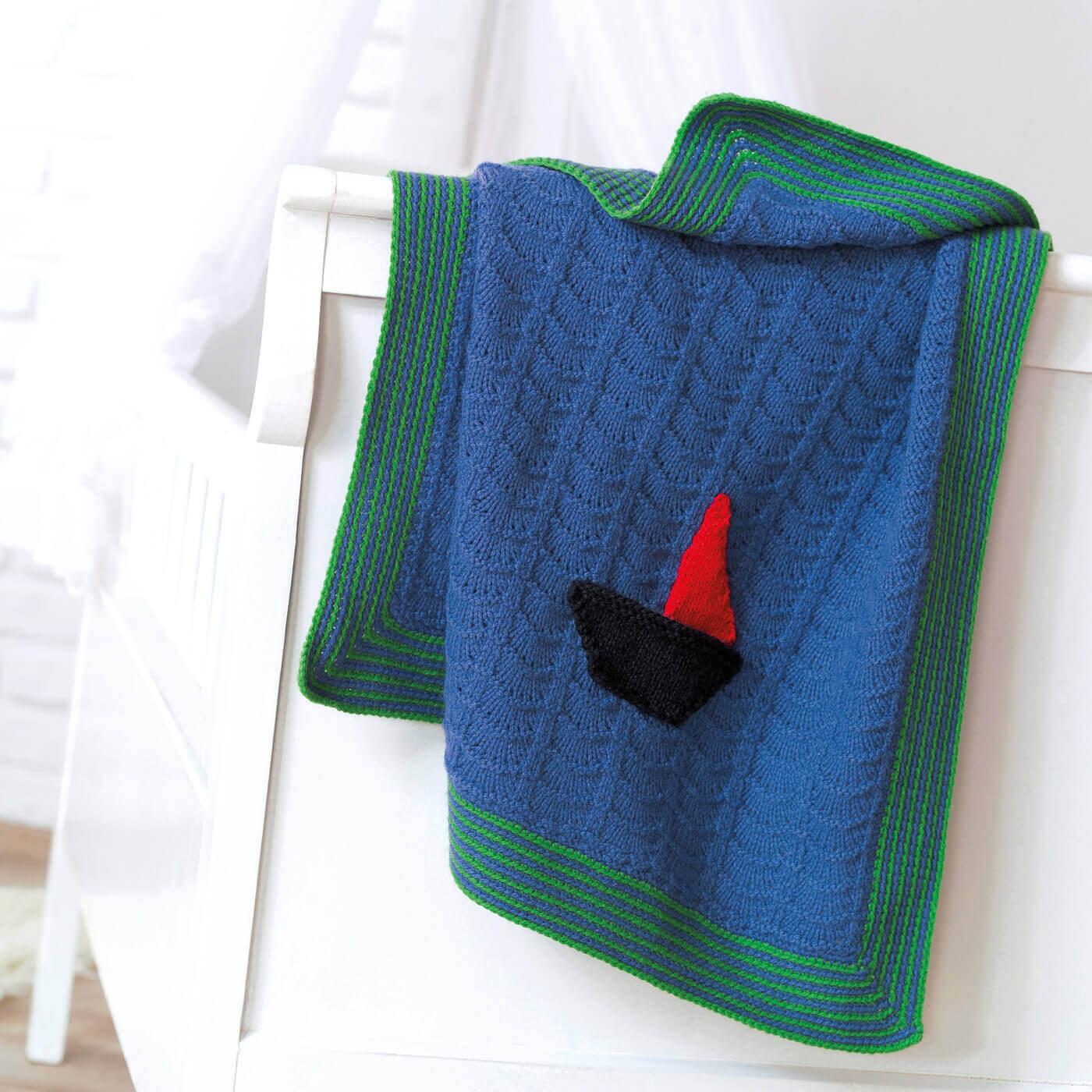 Strickdecke für Kinder mit Segelboot